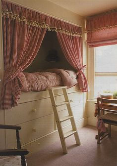 This reminds me of my room when I was a kid - although I didn't have the curtains around my bed.  Maybe that's why I have such an affinity towards nooks.  Cozy, fort type thing.