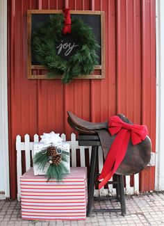 A dusty old saddle takes on new life as part of a Christmas vignette welcoming visitors to the barn.