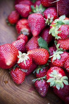 Strawberries, homegrown and sweetly kissed by sunshine. (Who wouldn't skip  the fungicides, pesticides, herbicides, petroleum-based fertilizers too, and radiated packaging?)
