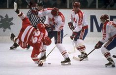 Tackla hockey. Canada's ERIC LINDROS (88) upends VYACHESLAV BUTSAYEV (22) of the Unified Team at the 1992 Winter Olympic Games in Albertville, France. The fall of the Berlin Wall in November of 1989 touched off a series of events that resulted in great upheaval for the world of international hockey that contiuned well into the 1990s.