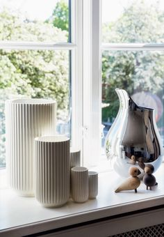 Large collection og the beautiful and minimalistic Lyngby Vases in the windowsill.