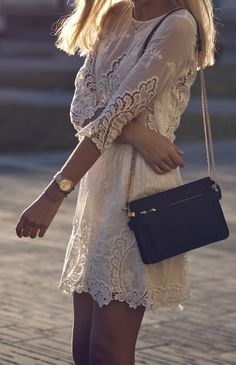 Lace dress and small black bag