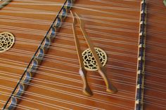 The hammered dulcimer is a percussion instrument with strings stretched over a trapezoidal sounding board. Another instrument, the appalachian dulcimer...