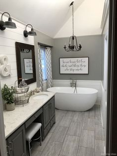 Tongue and groove accent wall, slab tile and grey wall colour 😍 Bathroom Renos, Grey Floor Tiles Bathroom, Shiplap Master Bathroom, Paint Bathroom Cabinets, Clawfoot Tub Bathroom, Wood Look Tile Floor, Master Bath Tile, Lake House Bathroom, Bathroom Towel Hooks