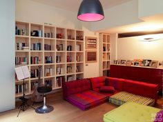 http://trainingjo.com/wp-content/uploads/2014/12/colorful-fabric-type-of-sofa-in-living-room-design-with-round-pendant-lamp-along-with-wooden-book-shelves-idea-on-the-wall-also-green-benches-table-including-wooden-floor.jpg