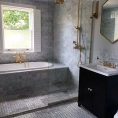 Marble and brass, a winning combination in this family bathroom @firedearthuk @lefroybrooksofficial @westelmuk #marble #brass #bathrooms #interiors #interiordesign #firedearth #westelm #lefroybrooks