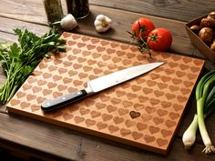 Personalized Carved Heart Engraved Wood Cutting Board - 12x16 - custom Mothers Day wedding or anniversary gift for foodie couple. $45.00, via Etsy.
