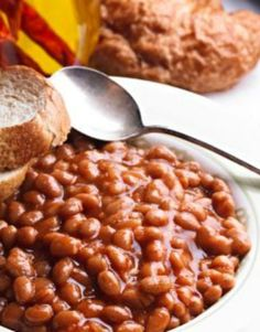 These delicious (and healthy) Boston Baked Beans are made in the slow cooker! 1 pound dry white Northern beans 1 c onion, diced fine 2 slices bacon cut into small pieces 1/4 c brown sugar  1/4 c dark molasses 1 T brown mustard 2 T ketchup 1/2 t salt 1/2 t black pepper 3 c water