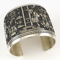 Wide Sterling Silver Cuff Bracelet with Intricate Hopi Overlay Designs of a Night Time Kachina Dance. From left to right, this cuff features a Red Tail Hawk, Velvet Shirt Kachina, Mudhead Drummer, Ho-