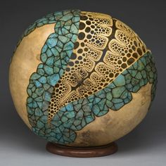 "Kelly's Gourd"" 12""h x 12""w x 5""d. Carving by Mark Doolittle; paper applique by Kathy Doolittle. George Post, photography."