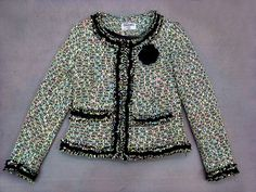 Chanel tweed jacket. This would be amazing with a pair of skinny jeans and heels!