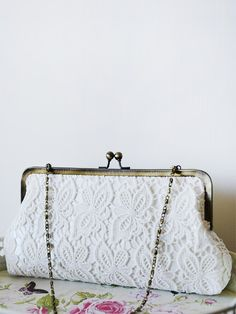 Elegant White Butterfly Lace Kiss Lock Clutch for your special day.  www.goo.gl/I679lh For more details please follow the direct link to #clutchmehoney website. #luxury #clutch #eveningclutch#eveningbag #bag #bridalclutch#bridalaccessories #fashionaccessories#accessorise #bride #brides #bridal #sparkling #bridalideas#bridalinspiration #bridesmaid#bridesmaids #weddingpurse #weddingclutch #clutch #Clutches