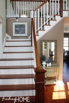 Entryway-Staircase-Renovation - practically what we already did. Bright white risers  pickets with wood rails  treads. Sandstone by Behr was our paint choice with all bright white trim.