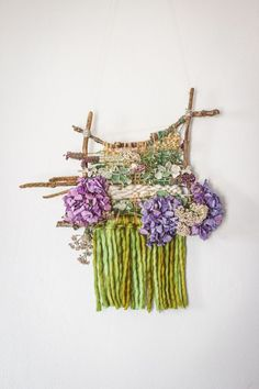 Nature weaving with a hand-tied stick frame loom is a fun craft for both kids and adults. When you are done, hang it up for a beautiful plant craft wall hanging. << READ BLOG for basic supplies and instructions for a nature weaving craft project >> Plant Crafts, Weaving Wall Hanging, Fun Crafts, Loom, Crochet Necklace, Craft Projects, Frame, Plants, Handmade