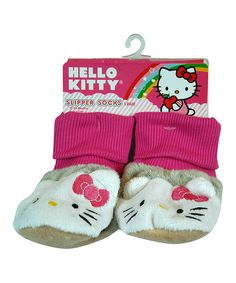 Average socks simply keep feet warm, but this pair does way more! Not only do they feature an adorable cuddly companion that'll join a sleepy sweetie on dreamland adventures, they've got grippers on the bottom to prevent slipping and sliding down the hall. Toasty toes with lots of character? The gift of socks just got way more fun.