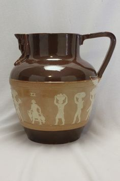 A very attractive Doulton Lambeth stoneware jug with an Egyptian motif. www.chinaroseantiques.com.au