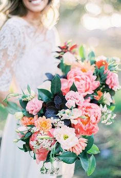 Breathtakingly beautiful pink flower wedding bouquet with green leaf detail; Featured Photographer: Natalie Bray Photography