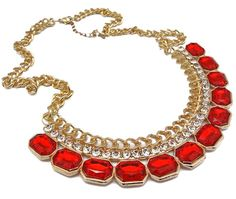 Bib necklaces are trending, statement pieces are a growing necessity in style. This golden bib necklace features vibrant red crystals that pop in color, along with shiny clear crystals al on a long golden chain.