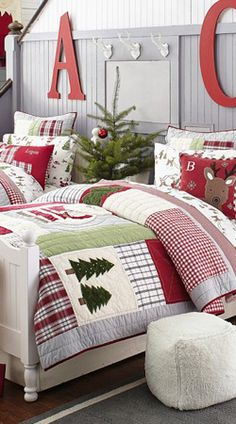 Dear Santa Quilted Bedding from Pottery Barn Kids - squares and strips of textural flannel, corduroy, sherpa and gingham in cheerful colors form this holiday patchwork.