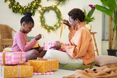 A mother and daughter sitting on the floor at home sharing and opening Christmas gifts together. Stylist: Bielle Bellingham Photographer: Micky Wiswedal Stylists, Christmas Gifts, Daughter, Floor, Stock Photos, Xmas Gifts, Pavement, Christmas Presents, Boden