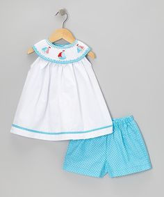 Take a look at this White Sailboat Smocked Swing Top & Blue Shorts - Toddler & Kids by Sweet Teas Children's Boutique on #zulily today!