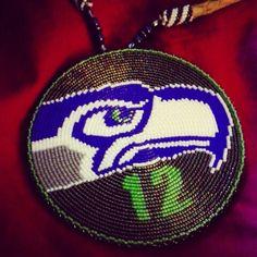 """4"""" seahawks medallion hand beaded on 30"""" leather necklace $200  Order: Rachael.borninabarn@gmail.com  Facebook.com/rachaelsborninabarn"""