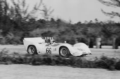Jim Hall in his Chaparral 2C at the 1965 Nassau Trophy race.  A front suspension failure while leading resulted in a crash that ripped off the right rear wheel. Taken back to Midland, the chassis was repaired and rebuilt into the new 2E. Albert R. Bochroch photo.