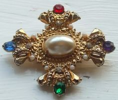 Tudor style vintage brooch. Superb Tudor jewellery with a decorated cross of gold tone metal.