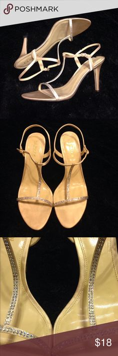 """Ralph Lauren Abita Champagne heels size 11 Ralph Lauren Abita Champagne heels, good condition with some minor signs of wear Open toe T-Strap Adjustable buckle strap closure Crystal accents on vamp Lightly cushioned footbed 4"""" heel height Comes in original Lauren Ralph Lauren box Ralph Lauren Shoes Heels"""