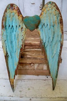 Metal wall wings with heart robins egg blue rusty distressed sculpture home decor Anita Spero via Etsy