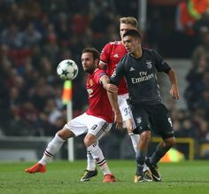 Juan Mata of Manchester United in action with Raul Jimenez of Benfica during the UEFA Champions League group A match between Manchester United and SL...