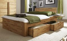 Boxspring bed covered in wooden frame