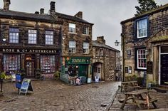 would be fabulous to live here!----The Bronte-obsessed town of Haworth: Exploring the cobbled streets of Haworth, a pretty little English village that clings to the edge of the West Yorkshire moors, and the landscape beyond. Welcome to Bronte Country. Yorkshire England, West Yorkshire, Yorkshire Dales, Yorkshire Towns, The Places Youll Go, Places To Visit, English Village, England And Scotland, Short Break