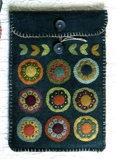 Blossoms Kindle cover wool applique pattern by Black Mountain Needleworks Penny Rug Patterns, Wool Applique Patterns, Felt Applique, Quilt Patterns, Penny Rugs, Capas Kindle, Felted Wool Crafts, Felt Crafts, Diy Crafts