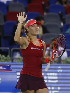 Camila Giorgi Photos - Angelique Kerber of Germany waves to spectators after winning the match against Camila Giorgi of Italy on day 4 of 2015 Dongfeng Motor Wuhan Open at Optics Valley International Tennis Center on September 30, 2015 in Wuhan, China. - Camila Giorgi Photos - 172 of 421