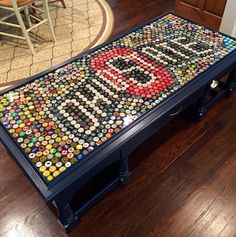 Here is Cal's Ohio State University Beer Cap Table...   (painted Goodwill table with top trim added to contain the caps and glaze)...complet...