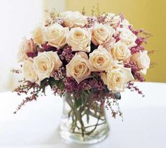 Sweetheart table arrangements? But with big light yellow roses