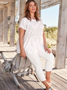 Warm weather calls for lighter-than-air fabrics, boho inspiration, and refreshing hues. Well, this top checks all those boxes and more. The flit-and-float white challis rocks country-fied floral and geo stitch embroidery all over the front. The scalloped hem and crochet trim are extra sweet touches.