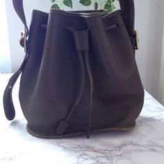 Vintage Olive Coach bucket tote Adorable bucket tote with draw string. Slumped soft leather and perfect you se every day. I love this bag so much Coach Bags Totes