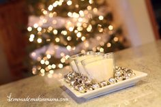 jingle bells and candles as a centerpiece. love it.