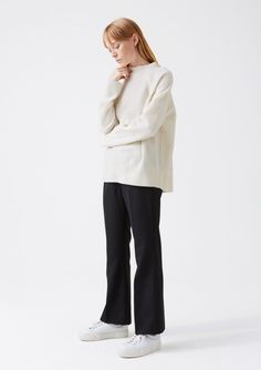Sweater: Echo sweater, off white Trouser: Epic trouser, black twill