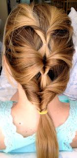Take a section of hair and pull it back into a ponytail. Then loop it through (over and under, though under and over could work too.  Connect the top two then start fresh for the bottom two, and then pull it all into a ponytail at the bottom.