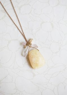 """Upcoming Engagement Necklace 45.99 at shopruche.com. A delicate brass necklace is adorned with a pale, honey hued stone and a cluster of shimmering beads in barely there colors.  18"""" long"""