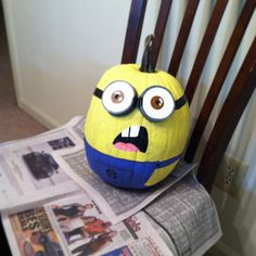 My minion pumpkin I painted for Halloween! It was so much fun :) Michael painted a mini minion, but his isn't done, so I couldn't post. I used pasta sauce lids for the eyes/goggles and electrical tape for the goggle band. I used the cheapest acrylic paint that I could find at Hobby Lobby. MKT