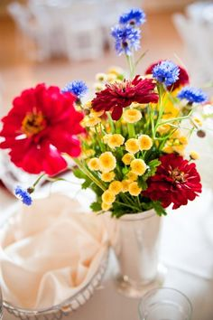 I like this, because the red/blue/yellow combonations isn't too primary school-ish.  Fall 2011 Wedding Flowers Photos on WeddingWire