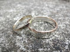 A pair of silver and gold wedding rings #wedding