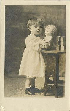 Small Girl with Blocks and Strange Doll - Real Photo Postcard