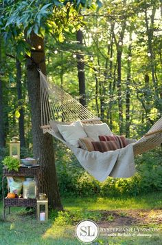 Napping corner in the backyard with comfy pillows and blanket on a hammock