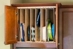 Ever since the first time I saw it Ive wanted vertical storage in an upper cabinet for my cookie sheets cutting boards serving trays and other narrow kitchen items. My parents had it in Kitchen Cabinet Organization, Kitchen Organization, Kitchen Storage, Kitchen Organizers, Cabinet Storage, Organization Hacks, Oven Cabinet, Cabinet Ideas, Organizing Ideas