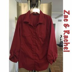 Red button down blouse Zac & Rachel burgundy button down blouse. Size: XL. A large can fit this as well. Color: Burgundy. Stretch material on sides on blouse. Fits standard. Not oversized. Button down blouse. Purchased from Ross. 67% Cotton, 27% Polyester, and 5% Spandex. Machine wash or hand wash in cold water.  Zac & Rachel Tops Button Down Shirts